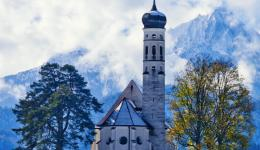 church and alps and sky