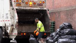 garbage truck and man loading