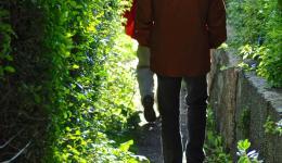Two men walking in single file