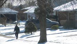 person walking down street in winter
